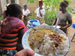 My midmorning snack on this day includes 50 CFA of rice with spicy tomato sauce on the right and 50 CFA of beans with gari and palm oil on the left. I really enjoy when both the rice vendor and the beans vendor show up at the same time so I can eat the two together. The Beninese think I'm bizarre. They eat rice or beans but generally don't mix them.