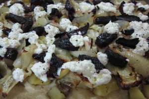 Pizza with roasted cabbage, beets, potatoes, onions and fresh ricotta